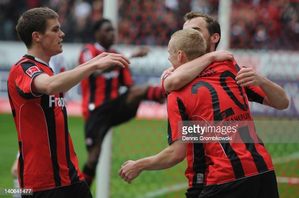 Erwin Hoffer of Frankfurt celebrates with teammates Sebastian Rode and Sebastian Jung after scoring his team's opening goal during the Second...