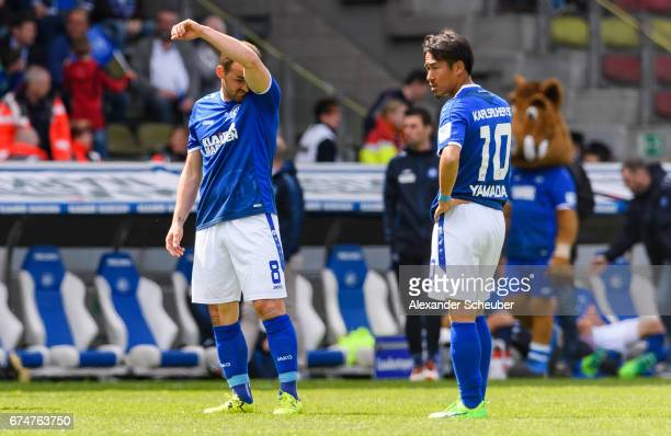 Erwin Hoffer of Karlsruhe and Hiroki Yamada of Karlsruhe are disappointed during the Second Bundesliga match between Karlsruher SC and 1 FC...
