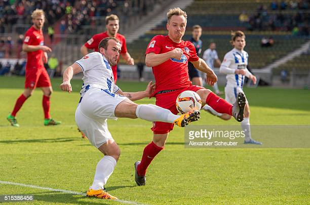 Erwin Hoffer of Karlsruher SC challenges Arne Feick of 1 FC Heidenheim during the second bundesliga match between Karlsruher SC and 1 FC Heidenheim...
