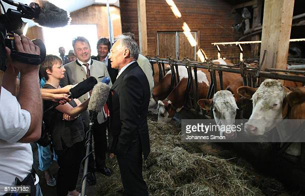 Erwin Huber head of the CSU and Bavarian Economic Minister addresses the media in the cow barn of milk farmer Hans Doeringer during an information...
