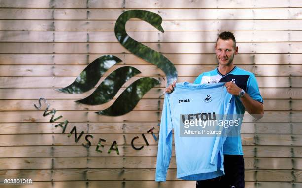 Erwin Mulder holds a shirt at the Swansea City Training at The Fairwood Training Ground on June 19 2017 in Swansea Wales