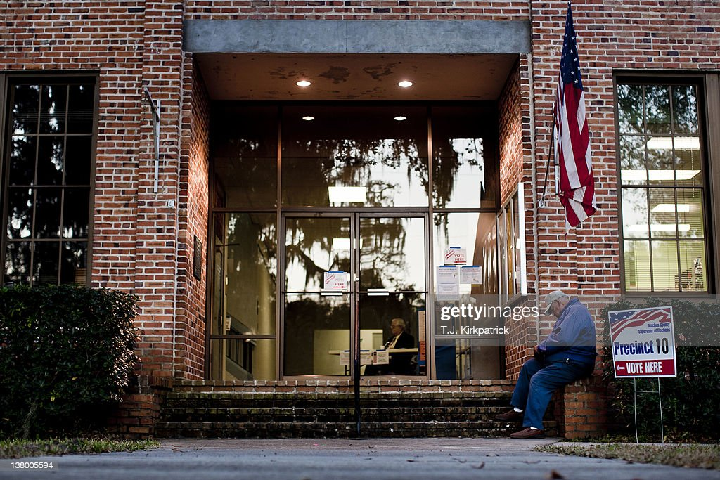 Erwin Reddick, of Micanopy, Fla., sits outside the entrance to the polling location at Micanopy Town Hall as Florida voters head to the polls in the state's Republican party primary on January 31, 2012 in Micanopy, Fla. After a decisive South Carolina win, former House speaker Newt Gingrich has risen and fallen in the polls and trails former Massachusetts Gov. Mitt Romney by double digits going in to Florida's primary.