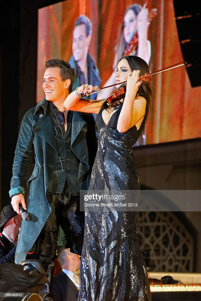 Erwin Schrott and a violinist perform during the 'Life Ball 2013 - Show' at City Hall on May 25, 2013 in Vienna, Austria.