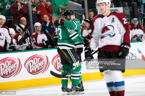 Esa Lindell and Devin Shore of the Dallas Stars celebrate a goal against the Colorado Avalanche at the American Airlines Center on October 14 2017 in...