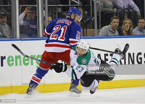 Esa Lindell of the Dallas Stars is tripped up by Derek Stepan of the New York Rangers during the third period at Madison Square Garden on January 17...