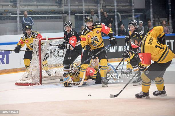 Esa Pirnes and Mika Pyorala of Karpat Oulu and Andreas Driendl David Fischer and Herberts Vasiljevs of Krefeld Pinguine during the Champions Hockey...