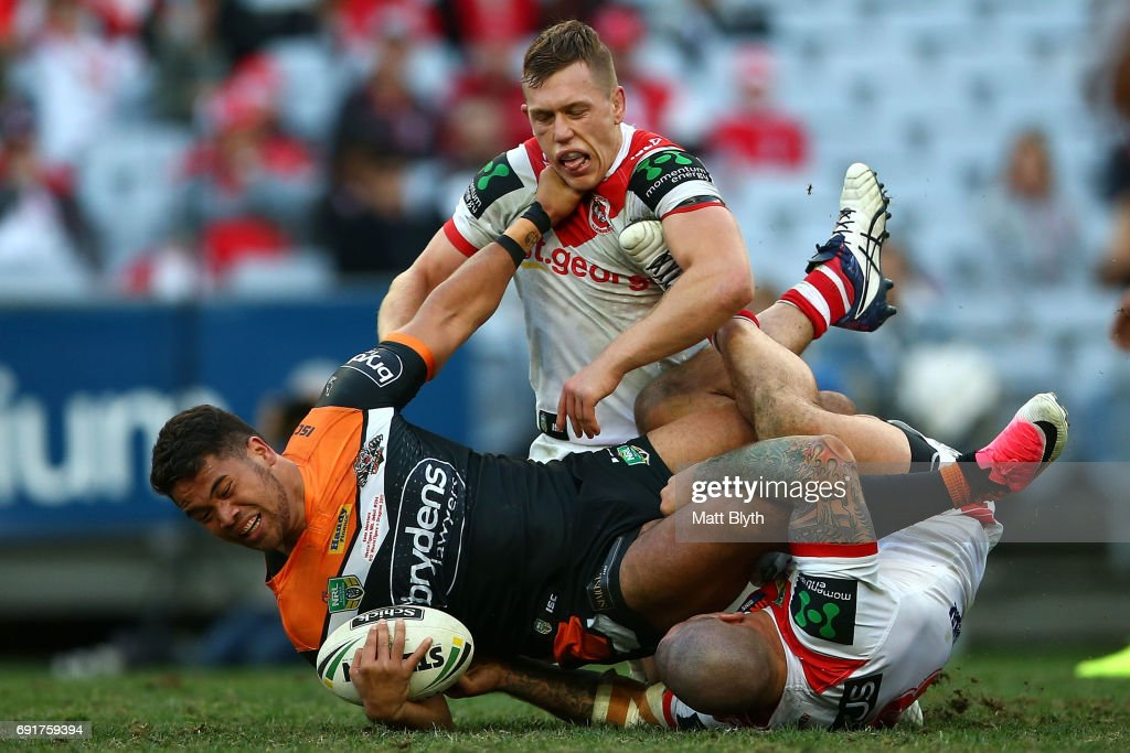 Esan Marsters of the Tigers is tackled during the round 13 NRL match between the St George Illawarra Dragons and the Wests Tigers at ANZ Stadium on June 3, 2017 in Sydney, Australia.