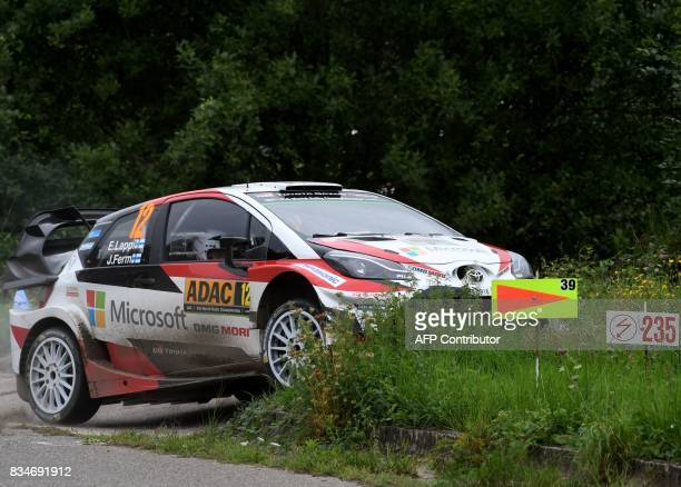 Esapekka Lappi of Finland and his codriver Janne Ferm of Finland steer their Toyota Yaris WRC during stage 3 of the Rally Germany in Klueserath near...