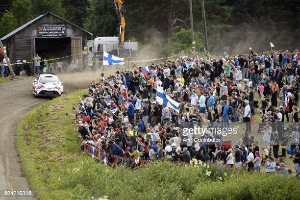 Esapekka Lappi of Finland and his codriver Janne Färm of Finland steer their Toyota Yaris WRC car during the Ouninpohja special stage of the Neste...