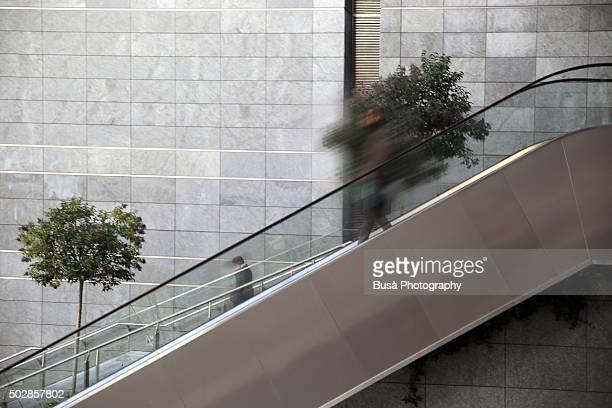 Escalator against a grey wall