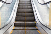 escalator in the building zooming for detail