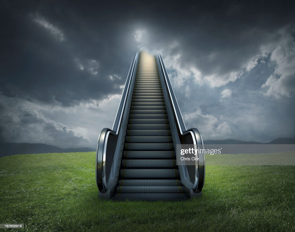 Escalator to cloudy sky in rural landscape : Stock Photo