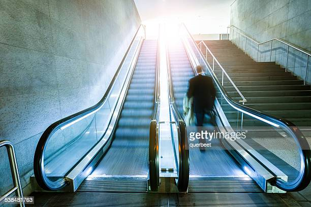 Escalator with businessman