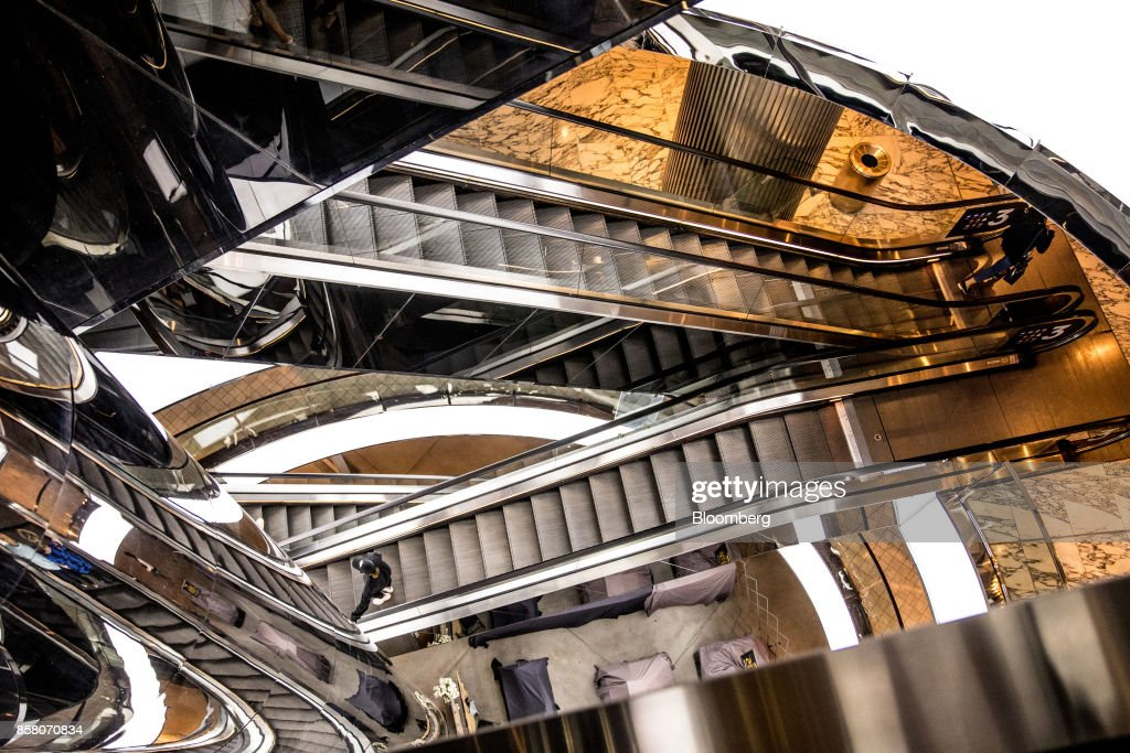 Escalators are illuminated in a shopping mall in Sydney, Australia, on Friday, Sept. 29, 2017. A bungled transition from coal to clean energy has left resource-rich Australia with an unwanted crown: the highest power prices in the world. Photographer: Cole Bennetts/Bloomberg via Getty Images