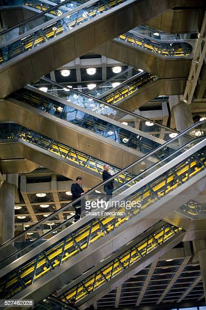 Escalators carry staff and brokers through the Lloyds Building in London The modern building was designed by Sir Richard Rogers at Number One Lime...