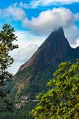 Escalavrado mountain, the National Park of the Organ in the State of Rio de Janeiro, Brazil, South America. Cloud on the mountain top.