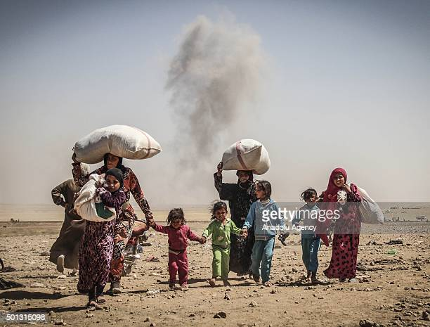 Smoke rises from Rasulayn region of AlHasakah as Syrians cross into Turkey from the borderline in Akcakale district of Sanliurfa on June 06 2015