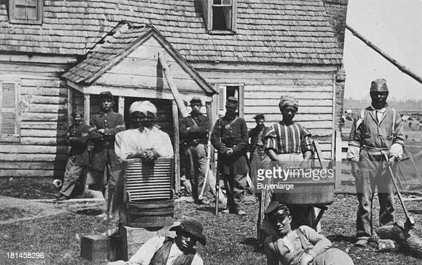 Escaped slaves working as washerwomen at a Union general's headquarters Escaped slaves were referred to as 'contrabands' an expression coined by...