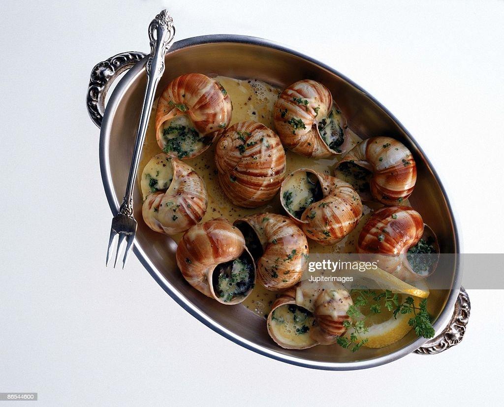 Escargot on silver platter