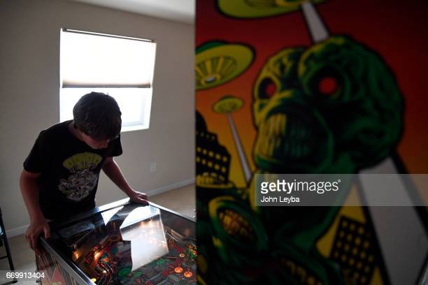 Escher Lefkoff a 13yearold Longmont shows off his skill on the Attack from Mars pinball machine on April 17 2017 at his home in Longmont The...