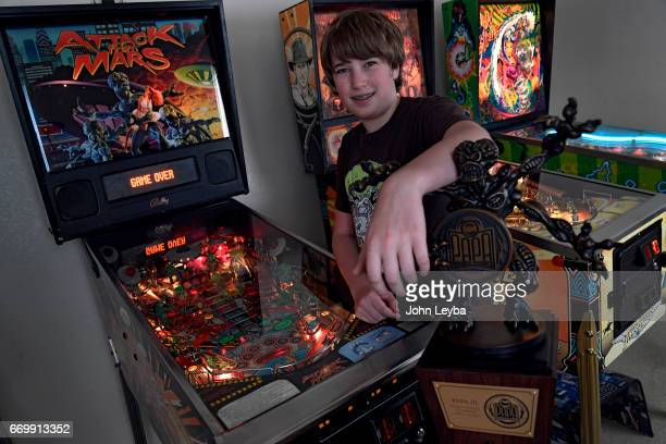 Escher Lefkoff a 13yearold Longmont with his trophy in from of Attack from Mars pinball machine on April 17 2017 at his home in Longmont The...