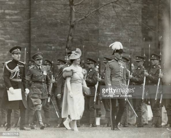Escorted by brigadier R O Alexander the Queen goes to present colors to her regiment Toronto Scottish