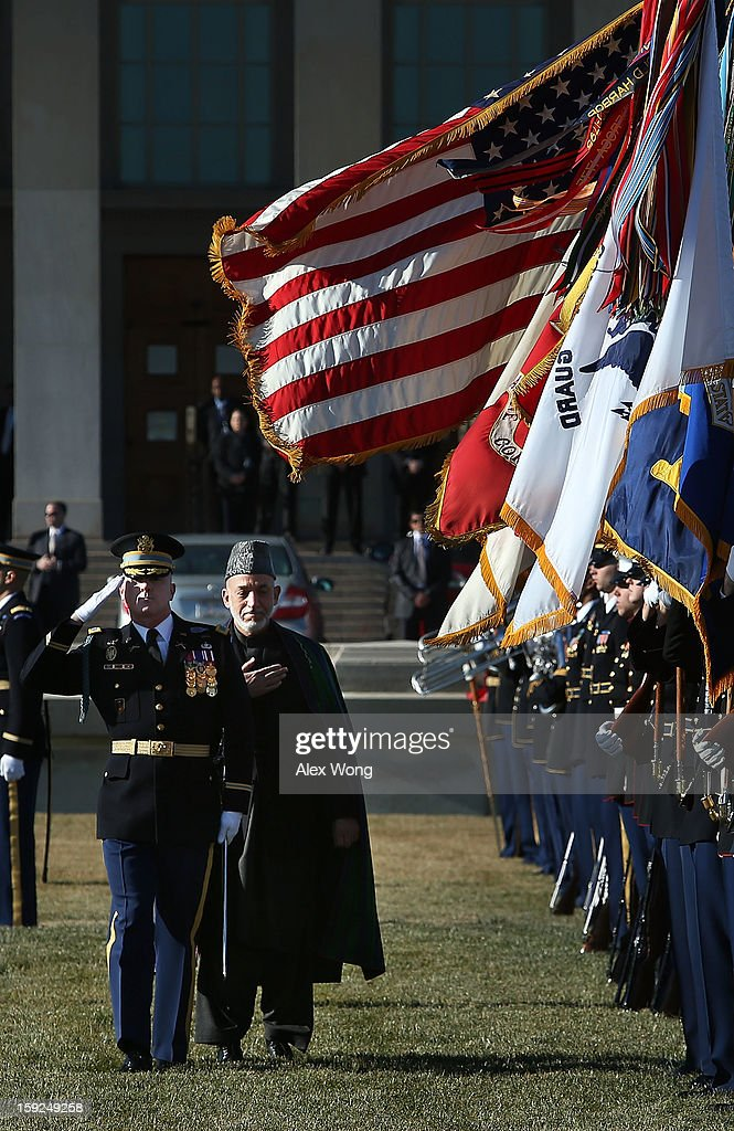 Escorted by Commander of Troops Col. James Markert (L), Afghan President <a gi-track='captionPersonalityLinkClicked' href=/galleries/search?phrase=Hamid+Karzai&family=editorial&specificpeople=121540 ng-click='$event.stopPropagation()'>Hamid Karzai</a> (2nd L) reviews the honor guards during a full military honors ceremony welcoming Karzai to the Pentagon January 10, 2013 in Arlington, Virginia. Karzai is on a visit in Washington, to include a meeting with U.S. President Barack Obama at the White House, to discuss the continued transition in Afghanistan and the partnership between the two nations.