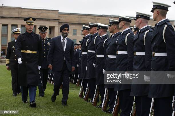Escorted by Regimental Commander of US Army 3rd Infantry Regiment Col Jason Garkey Canadian Minister of National Defence Harjit Sajjan Mexican...