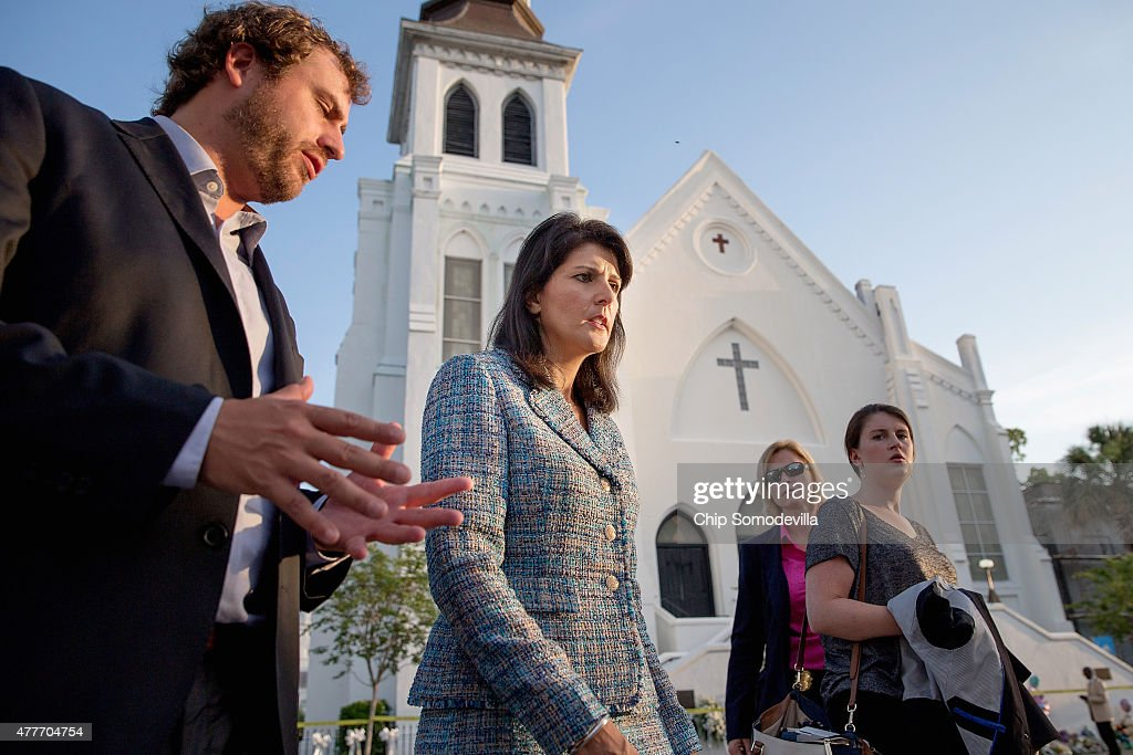 Escorted by staff and security South Carolina Governor Nikki Haley moves from one television interview to another across from the historic Emanuel...