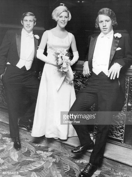 Escorting 1970 debutante Miss Rosanne Ricketson to year's most glamorous party the Debutante Ball were David Foley left and Philip Barrett Credit...