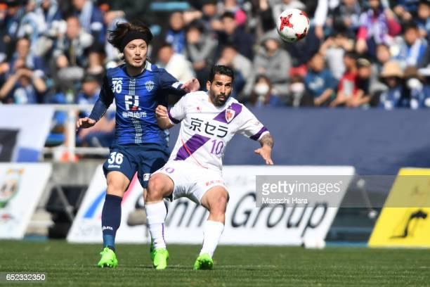 Escudero Sergio of Kyoto Sanga and Keisuke Iwashita of Avispa Fukuoka compete for the ball during the JLeague J2 match between Avispa Fukuoka and...