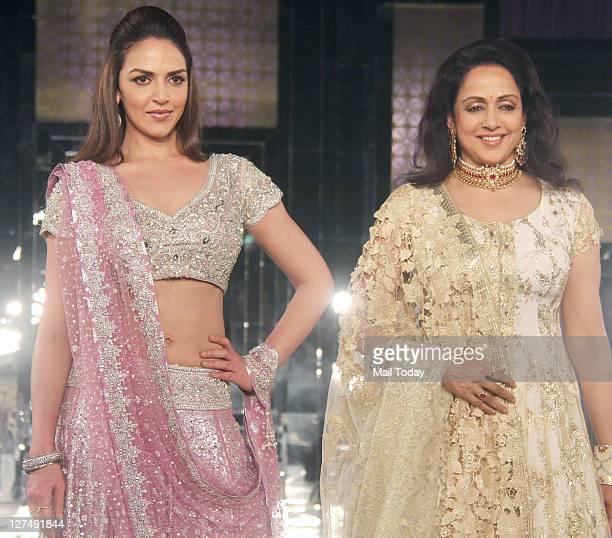 Esha Deol with mother Hema Malini walks the ramp for designer Neeta Lulla during Aamby Valley India Bridal Week 2011 fashion show held in Mumbai