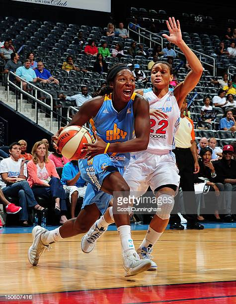 Eshaya Murphy of the Chicago Sky drives against Armintie Price of the Atlanta Dream at Philips Arena on August 22 2012 in Atlanta Georgia NOTE TO...
