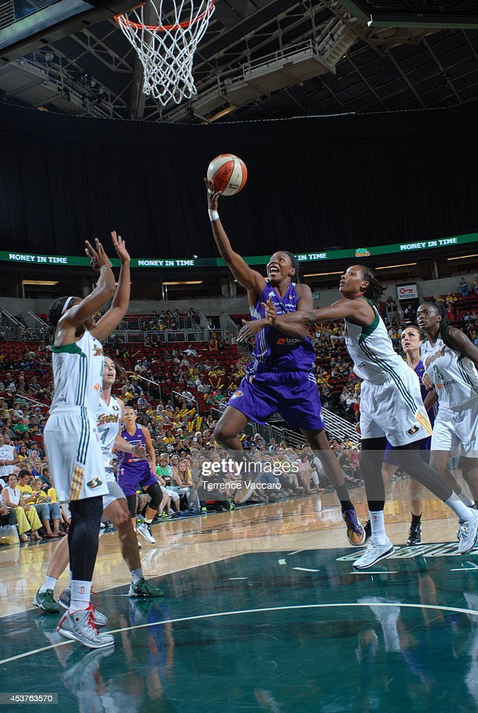 Eshaya Murphy #14 of the Phoenix Mercury goes to the basket against the Seattle Storm during the game on August 17, 2014 at Key Arena in Seattle, Washington.