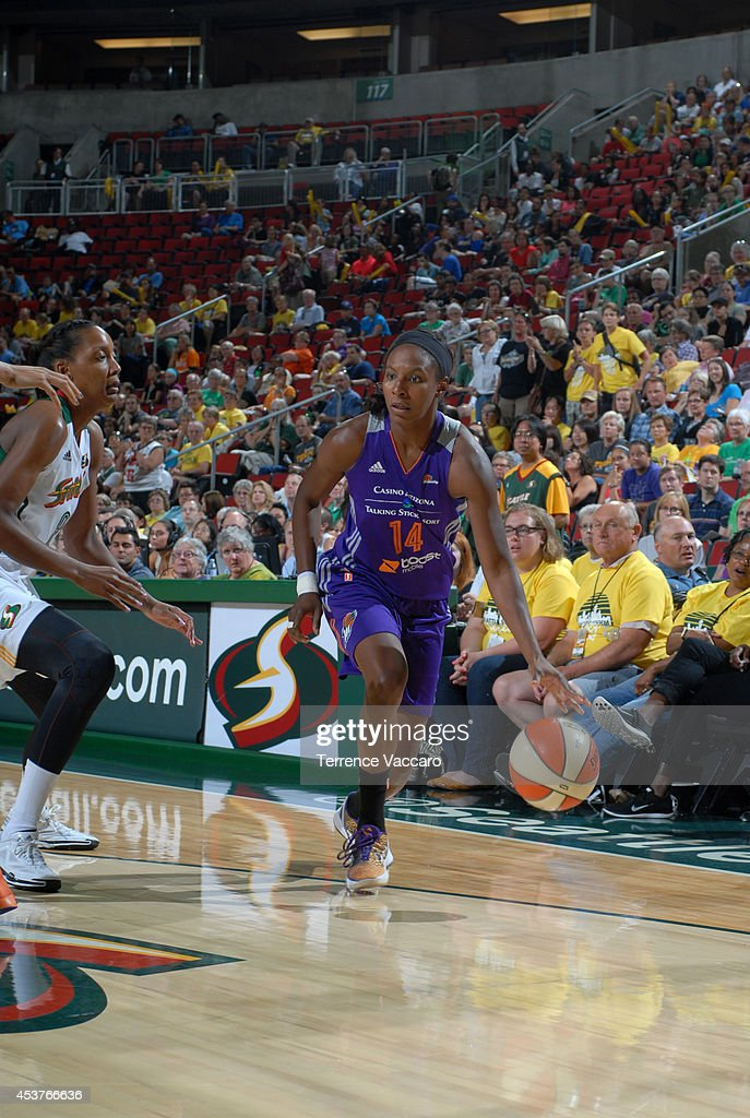 Eshaya Murphy #14 of the Phoenix Suns handles the ball against the Seattle Storm during the game on August 17, 2014 at Key Arena in Seattle, Washington.