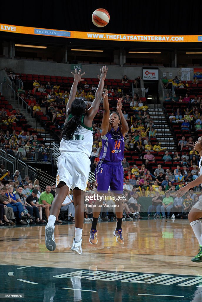 Eshaya Murphy #14 of the Phoenix Suns shoots the ball against Crystal Langhorne #1 of the Seattle Storm during the game on August 17, 2014 at Key Arena in Seattle, Washington.