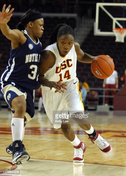 Eshaya Murphy of USC drives to the basket against Breona Gray of Notre Dame during 6958 victory at the Galen Center in Los Angeles California on...