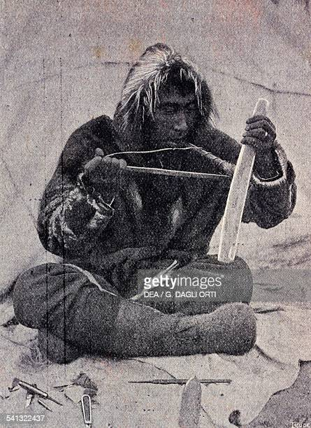 Eskimo intent to affect bone photograph from the Journal des Voyages 1908 Arctic 20th century