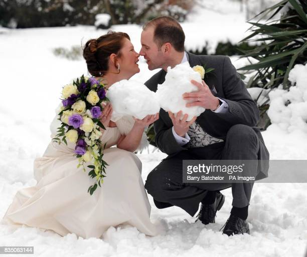 Eskimo kiss in the snow by newly weds Philip Cass and Natalie Britton from Bristol as they touch noses after their marriage at Tortworth Court Four...