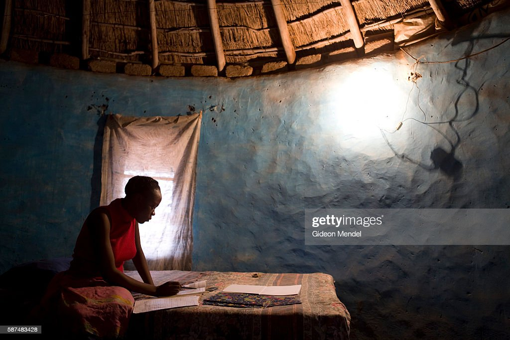 Eslinati Malulere uses electric light to do her schoolwork inside a traditional hut in the Makuleke village This might seem normal but the...