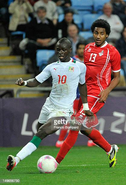 Esmaeel Khamisi of United Arab Emirates battles for the ball against Sadio Mane of Senegal during the Men's Football first round Group A Match...