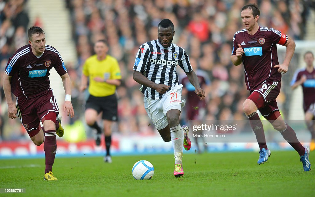 Esmael Goncalves of St Mirren and Andy Webster (Right) and Danny wilson of Hearts during the Scottish Communities League Cup Final between St Mirren and Hearts at Hampden Park on March 17, 2013 in Glasgow, Scotland.