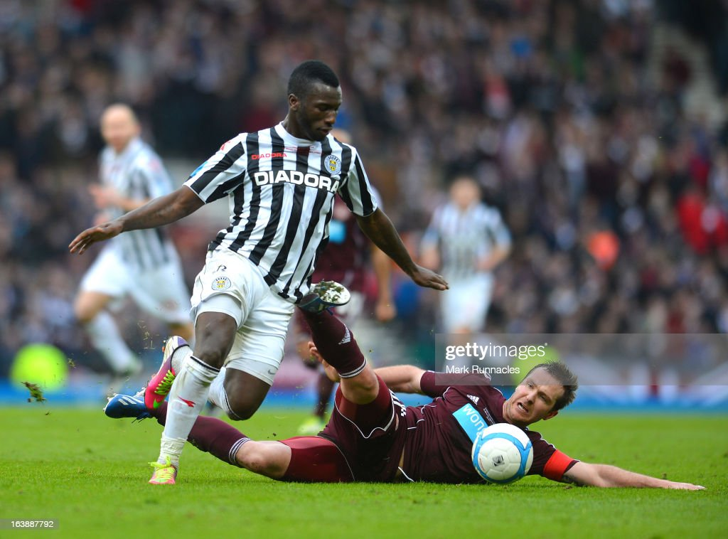 Esmael Goncalves of St Mirren and Andy Webster of Hearts during the Scottish Communities League Cup Final between St Mirren and Hearts at Hampden Park on March 17, 2013 in Glasgow, Scotland.
