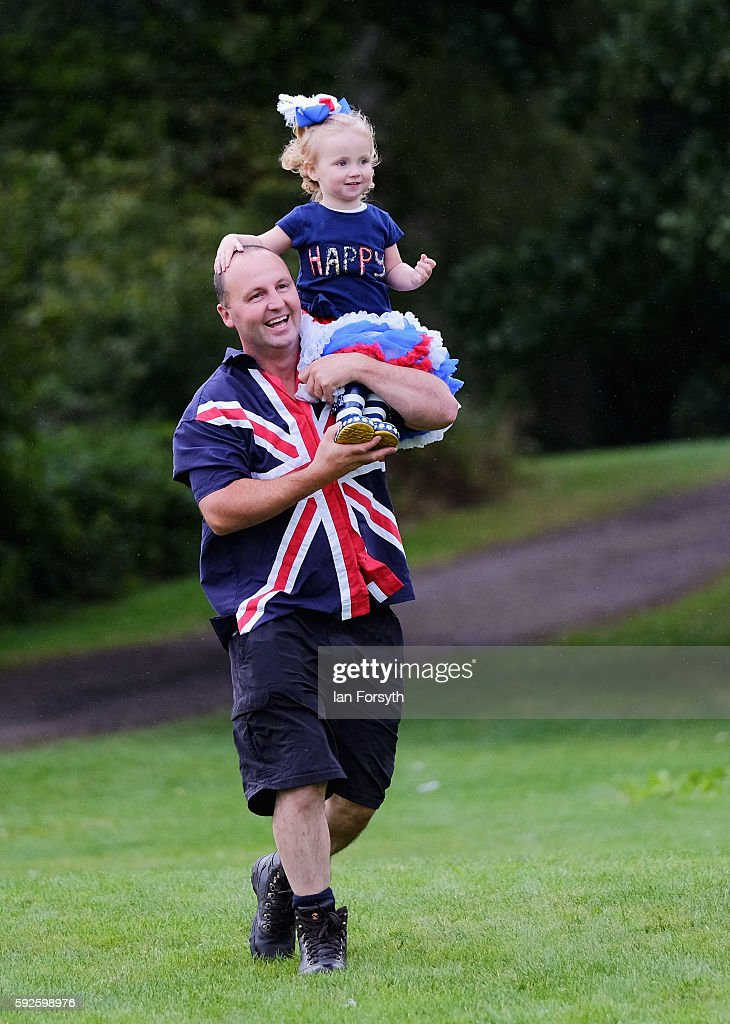 Esme Scott from Sunderland sits on her fathers shoulders as they arrive at the annual classical Proms Spectacular concert held on the north lawn of...