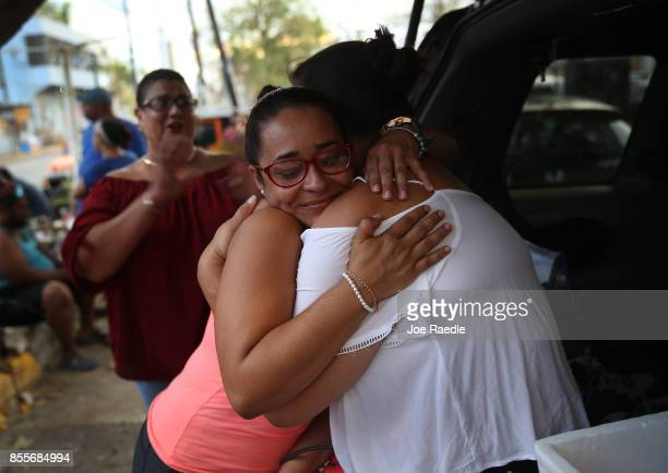 Esmeralda Santaella and Maritza Vega hug as they hang out together as the island deals with the aftermath of Hurricane Maria on September 29 2017 in...