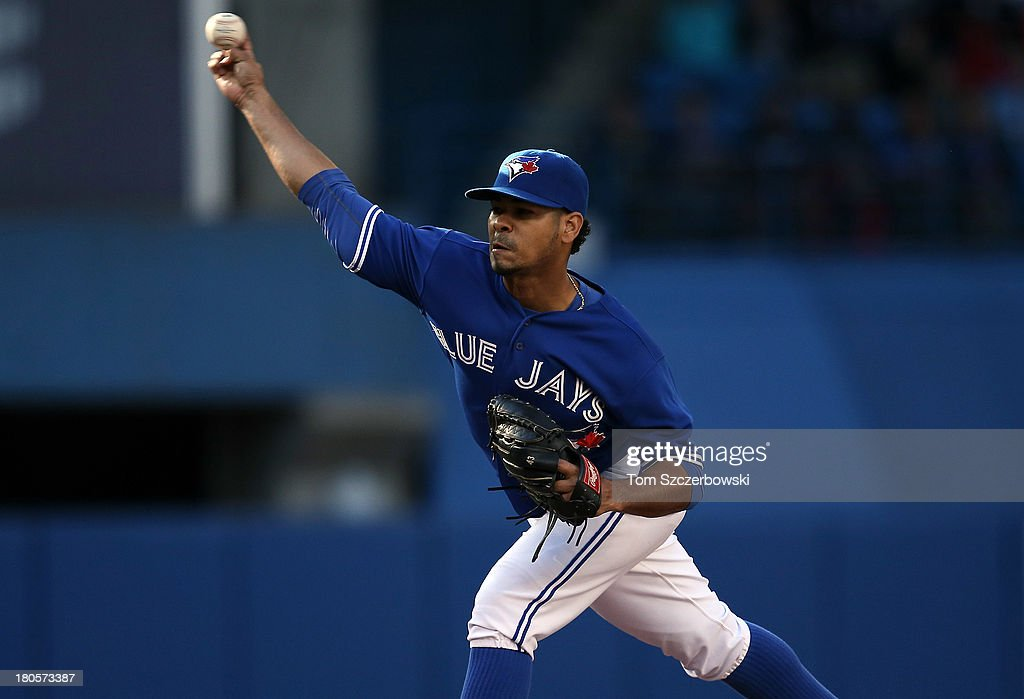 Esmil Rogers #32 of the Toronto Blue Jays delivers a pitch during MLB game action against the Baltimore Orioles on September 14, 2013 at Rogers Centre in Toronto, Ontario, Canada.