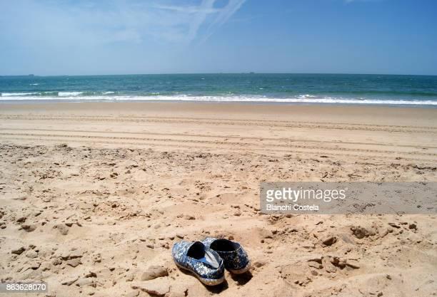Espadrilles in beach sand