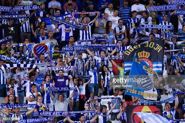Espanyol fans cheer on their team during the La Liga Match between RCD Espanyol and Sevilla FC at CornellaEl Prat Stadium on August 30 2014 in...