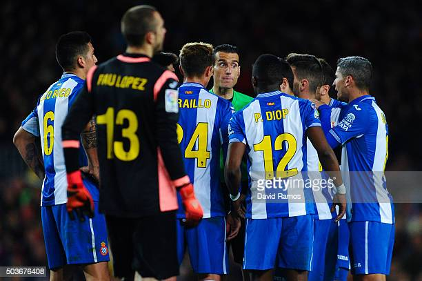 RCD espanyol players argue with the referee Juan Martinez Munuera during the Copa del Rey Round of 16 first leg match between FC Barcelona and RCD...