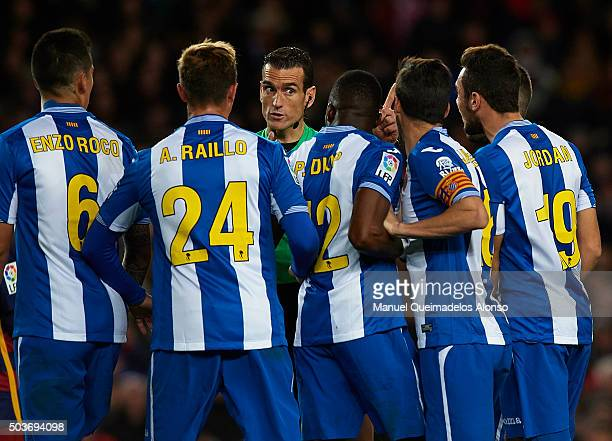 RCD espanyol players argue with the referee Juan Martinez Munuera during the Copa del Rey Round of 16 match between FC Barcelona and Real CD Espanyol...